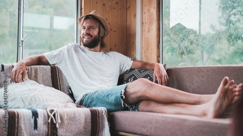 Young man laughing inside a stylish mobile home Canvas Print