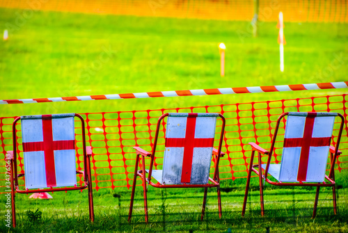 St George's cross on back of chairs on sports day in Beetham UK Fototapet