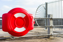 Close-up Of Red Buoy On Railing