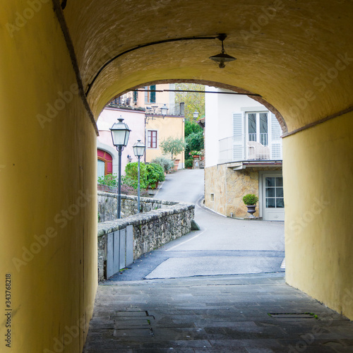 view across as covered walkway of the historic centre town, Greve in Chianti, Florence, Tuscany, Italy © Biba