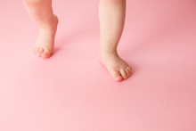 Infant Legs On Light Pink Floo...