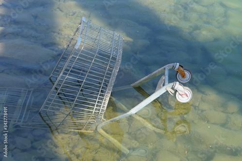 High Angle View Of Abandoned Shopping Cart In Lake Fototapeta