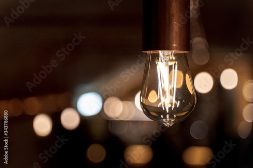 Closeup shot of a light bulb with light and blurred background Canvas Print
