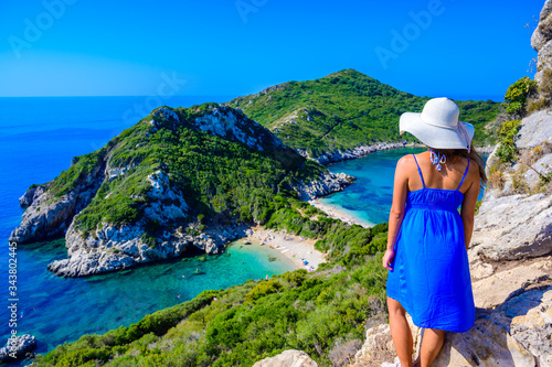 Girl with sun hat at Porto Timoni beach at Afionas is a paradise double beach wi Canvas Print