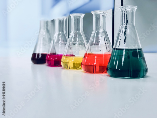 The Erlenmeyer or Conical flask on bench laboratory, with colorful solvent solution from titration experiment, acidity, alkalinity, and total hardness analysis compounding in wastewater sample Canvas Print