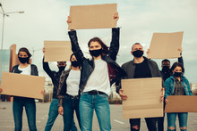 A Group Of People With Mask And Posters To Protest The Protest Of The Population Against Coronavirus And Against The Introduction Of Quarantine Meeting About Coronavirus And People Rights. Copyspace