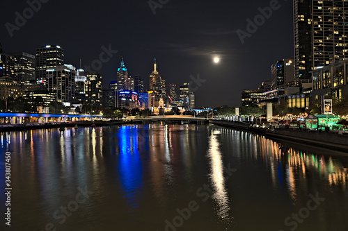 The skyline of Melbourne and the Yarra river during blood moon