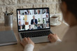 canvas print picture - Rear close up view of diverse businesspeople talk on webcam conference conversation brainstorming online, employees colleagues speak on video call on laptop, engaged in internet meeting or briefing