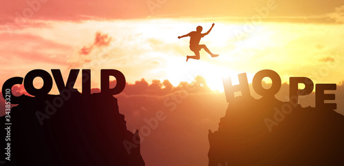Silhouette man jumps to survive from corona virus , COVID-19 Canvas-taulu
