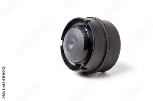 New modern electric black plastic beep - car horn on a white isolated background in a photo studio Canvas Print