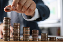 Male Hands In Suit Stack Coins...