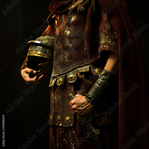 roman soldier with his armor and with black background Fototapeta