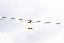 Sneakers Hang On The Power Line