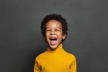 Happy Black Child Boy Laughing On Black Background