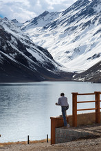 Lake In The Mountain And A Man