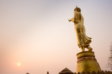Golden Buddha Statue Standing On A Mountain Wat Phra That Khao Noi, Nan Province, Thailand, City Of Cultural And Natural Tourism In The North Where The Air Is Cool.