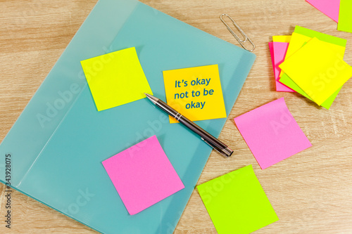 The saying 'It's okay not to be okay' written on a sticky note - positive affirm Canvas Print