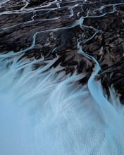 Aerial View Of Blue Textured Braided Glaciel Rivers, Lake Pukaki, South Island, New Zealand