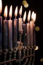 Lit Candles In Menorah