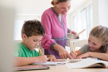 Mother Assisting Children (6-7...