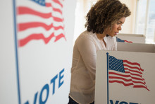 Young Woman In Voting Booth