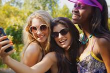 Happy Teenage Girl Friends Tak...