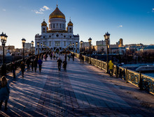 People Walking On Patriarshy Bridge Leading Towards Temple Of Christ The Savior