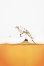 Orange Drink Splashing On Whit...