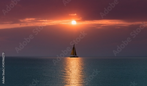Canvas Print sailboat at sunset