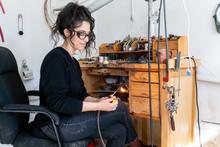 Female Artist Lights Blow Torc...