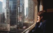Tween Boy Looking Out A Window...