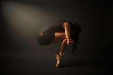 Dancer. Young Elegant Ballet Dancer, Dressed In Black Jersey, Shoes An