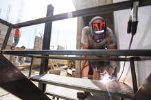 Construction Site Worker Weldi...
