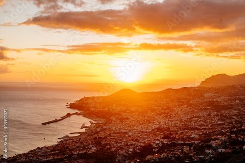 Ocean Sunset over Town in Portugal - 343971021