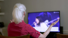An Older Woman Worshiping As S...