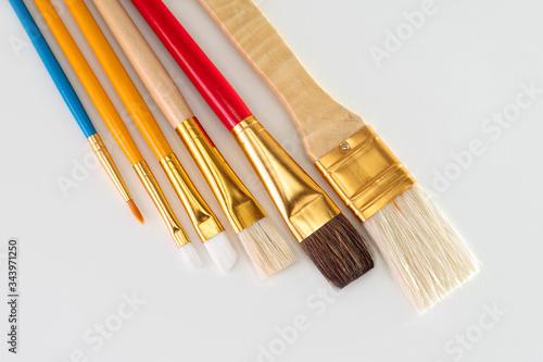 Different width paint brushes against white Fototapeta
