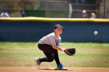 Baseball Pitcher Catching Ball On Baseball Field