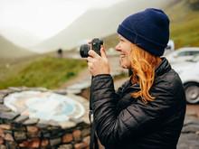 Woman Photographing Three Sist...