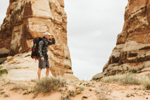 Hiker With Big Backpack Pauses...
