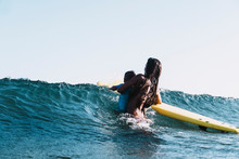 A Surfer Mother Surfing With H...