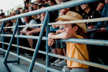 Girl Watching Rodeo While Sitt...