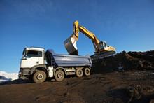 Earth Mover Filling Dump Truck