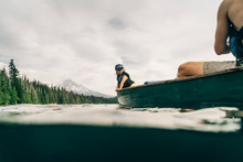 A Young Girl Rides In A Canoe ...