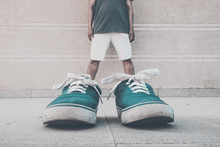Optical Illusion Of Man Wearing Green Shoes Against Wall