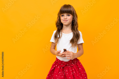 Photographie studio photo of an attractive caucasian girl on a yellow background