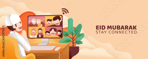 Photo Man Teleconference Call With His Family and Friends in Eid Mubarak Al Fitr From Home in Front of PC Monitor Full of Happiness