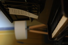 Close-up Of Piano Keys With Musical Notes