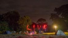 Illuminated Tents Against Sky At Night