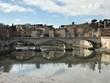 Ponte Sant Angelo Bridge Over Tiber River Against Buildings And Sky