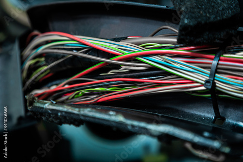 Close up of the engine control unit of the car, multicolored wires plug  - a wir Canvas